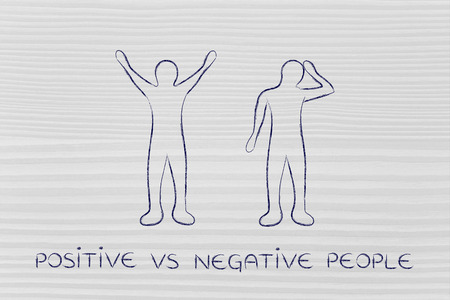 pessimist: positive vs negative people: man happily lifting his hands up in the air while another man is bending his head down in sadness or doubt Stock Photo