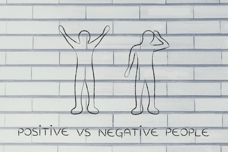 head down: positive vs negative people: man happily lifting his hands up in the air while another man is bending his head down in sadness or doubt Stock Photo