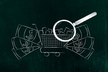 segmentation: magnifying glass analyzing a shopping cart full of products with oversize cash surrounding it, concept of market segmentation and profitable items that sell well
