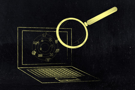 analyzed: laptop being analyzed by magnifying glass for viruses or other threats, concept of antivirus system scan