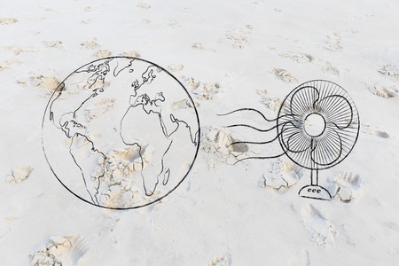 global warming concept: planet earth next to a funny electric fan to cool it down