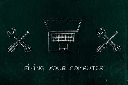malfunction: concept of fixing or setting up your computer: laptop next to wrench and screwdriver
