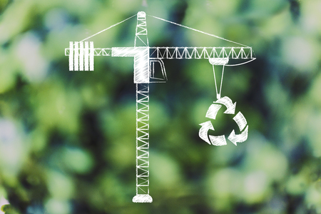 manmade: tower crane lifting up a recycle symbol, concept of sustainable development Stock Photo