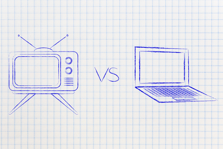 retro style television vs laptop computer, concept of choosing your favorite entertainment device Stock Photo