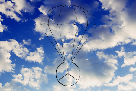 peace symbol with parachute protecting it, concept of supporting a peaceful future Stock Photo