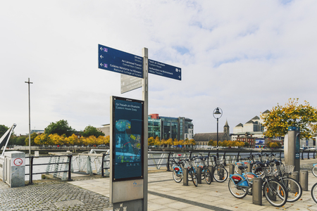 leinster: DUBLIN, IRELAND - Septembter 27th, 2016: View over the river Liffey walk and the business district featuring autumn coloured trees and city bikes in Dublin One district
