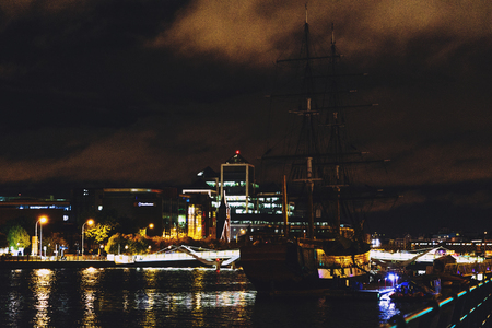DUBLIN, IRELAND - Septembter 26th, 2016: Dublins docklands on the river Liffey by night