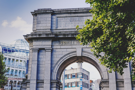 leinster: DUBLIN, IRELAND - 10th June, 2017: Arch at the entrance of St Stephens park and the shopping centre in the background, in Dublin city centre