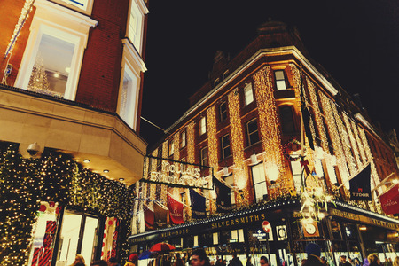 DUBLIN, IRELAND - November 17th, 2016: Detail of busy Grafton Street shopping hub in Dublin city centre with Christmas decoration