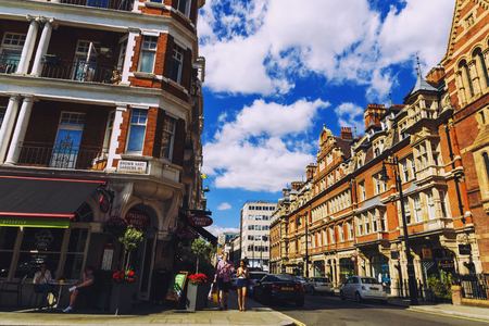 LONDON, UNITED KINGDOM - August 6th, 2016: Detail of beautiful buildings architecture in the streets of London city centre near Duke Street and Oxford Street