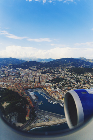 NICE, FRANCE - August 16th, 2016: Aerial view of the city of Nice, France and surrounding coastline while landing at Nice Airport on a serene summer afternoon 新聞圖片