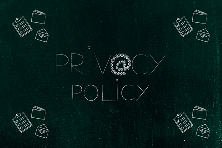 privacy policy concept: text with @ symbol made of locks and business objects next to it Stok Fotoğraf