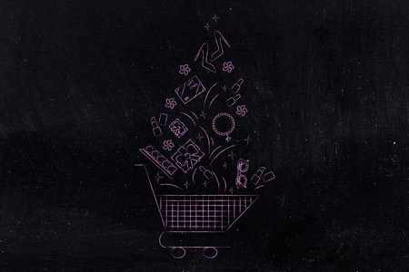web marketing: shopping and sales concept: shopping cart with plenty of fashion objects thrown inside of it