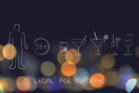 legal age to drink concept: cocktails next to sign with 18 as minimum age number and person