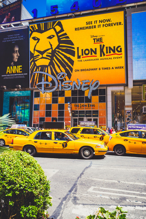 NEW YORK, NY - June 8th, 2014: detail of busy Broadway in Manhattan, NYC with yellow cabs and theatres