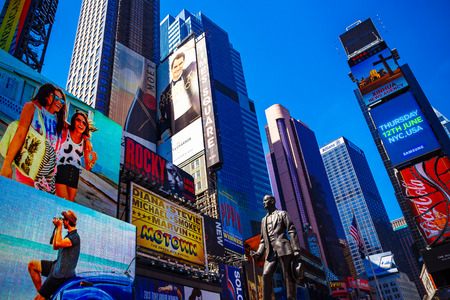 NEW YORK, NY - June 8th, 2014: detail of busy Times Square in Manhattan, NYC with statue, skyscrapers and billboards Editorial