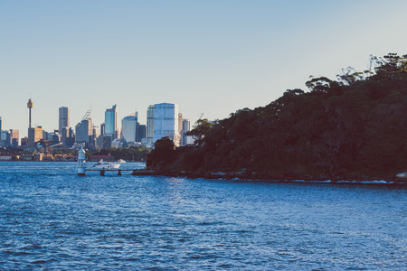 SYDNEY, AUSTRALIA - July 7th, 2013: Sydneys skyline and bay as seen from the ferry Editorial
