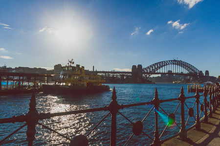 SYDNEY, AUSTRALIA - July 17th, 2013: view of Circular Quay in Sydney Harbour with view over the Harbour Bridge near the Central Business District