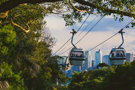 SYDNEY, AUSTRALIA - July 11th, 2013: Taronga zoo cable car with view over Sydneys skyline in the distance