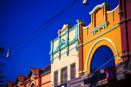 SYDNEY, AUSTRALIA - July 7th, 2013: colorful buildings in Manly Beachs main street the Corso