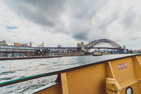 SYDNEY, AUSTRALIA - July 10th, 2013: Sydney Harbour Bridge shot during a ferry ride on an overcast winter day