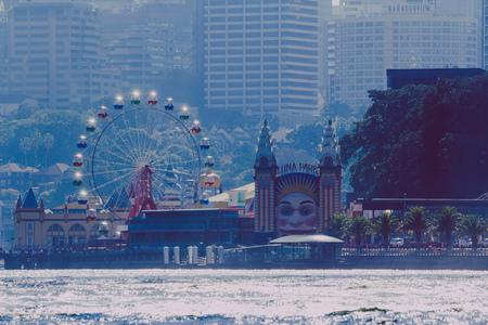 SYDNEY, AUSTRALIA - July 11th, 2013: Sydneys Luna Park and skyline seen from the ferry Editorial