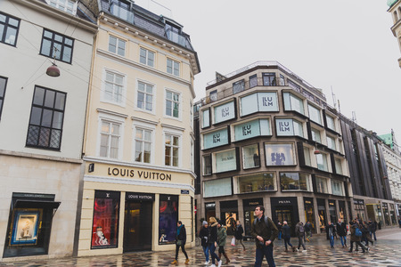 COPENHAGEN, DENMARK - March 11th, 2018: Architecture and buildings in the famous shopping street of Stroget in Copenhagen featuring the typical Scandinavian style