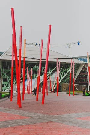 DUBLIN, IRELAND - April 7th, 2018: view of the Grand Canal Square area of Dublin Docklands featuring the Bord Gais Theatre and the luxury Marker Hotel