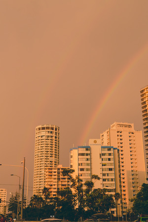 GOLD COAST, AUSTRALIA - January 6th, 2014: rainbow and stormy skies over the skyscrapers in Sufers Paradise, Gold Coast