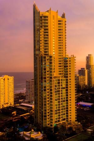 GOLD COAST, AUSTRALIA - January 6th, 2014: dramatic orange sunset over the coastline and buildings of Surfers Paradise in Gold Coast 報道画像