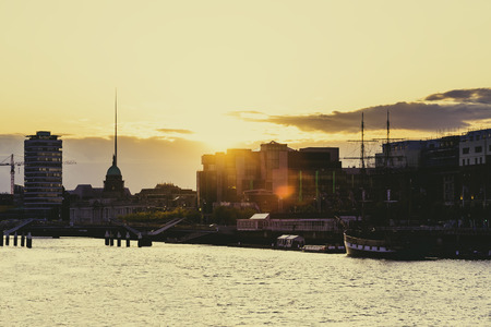 DUBLIN, IRELAND - April 30th, 2018: Sunset over the river Liffey and view of DUblin's skyline