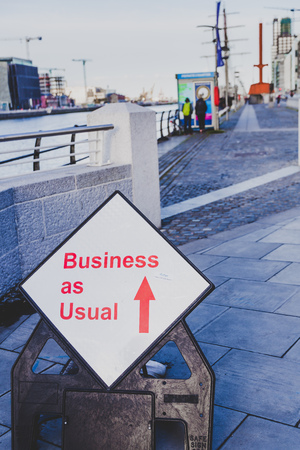 DUBLIN, IRELAND - May 12th, 2018: Business as usual road sign along the river Liffey in DUblin city centre
