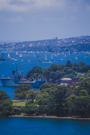 SYDNEY, AUSTRALIA - December 26th, 2014: view of Sydney Harbour, close-up shot of the coast and sea during the Sydney to Hobart yacht race