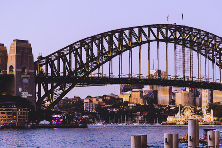 SYDNEY, AUSTRALIA - December 30th, 2014: the Sydney Harbour Bridge at dusk and view of the surrounding area