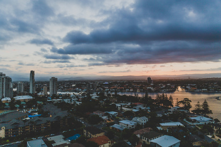 GOLD COAST, AUSTRALIA - January 15th, 2015: dramatic tropical sunset over Surfers Paradise with mountain view