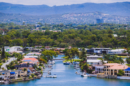 GOLD COAST, AUSTRALIA - January 9th, 2015: residential areas of Surfers Paradise with water inlets from the river and mountain view Editorial