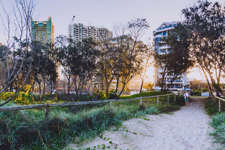 GOLD COAST, AUSTRALIA - January 7th, 2015: entrance path to the beach in Surfers Paradise with greenery next to it