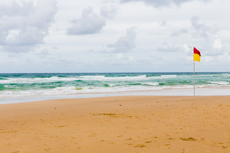 pristine beach in Gold Coast, Australia with its typical gold sand and big waves on the Pacific Ocean