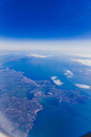 aerial view of the coast of Wales and England during a Dublin to London flight