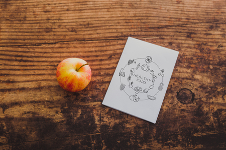 apple and healthy food note on memo paper on wooden table, concept of nutrition and diet Stock Photo