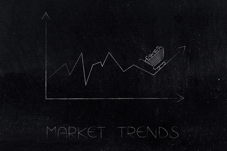 market trends conceptual illustration: stats graph with sales going up and shopping cart on top of the arrow Stock Photo