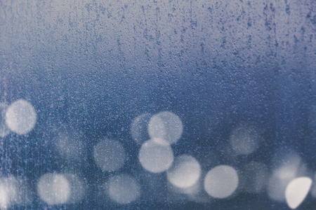 background with window and frost and city lights boke on the outside (composite of more than one shot) 写真素材