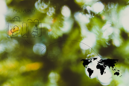 worldwide delivery concept: Christmas shopping bags with dashed line route to destination on world map