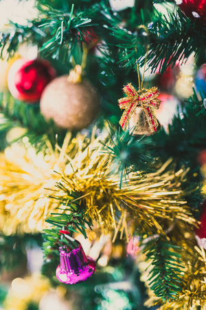 Christmas tree decorations and bells with golden tones shot at shallow depth of field
