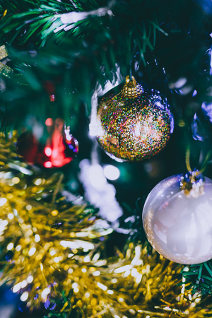 Christmas tree decorations and baubles with golden tones shot at shallow depth of field