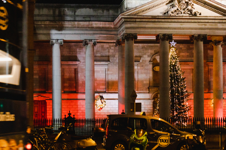 DUBLIN, IRELAND - December 19th, 2018: architecture and Christmas tree in Dublin city centre among the traffic