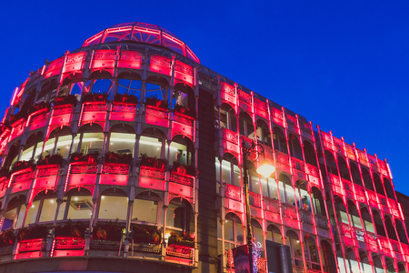 DUBLIN, IRELAND - December 19th, 2018: the exterior and facade of the Stephens Green shopping centre with red Christmas lights on