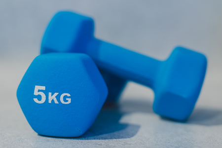 health and fitness resolutions, heavy dumbbells on concrete surface shot at shalow depth of field Stock Photo