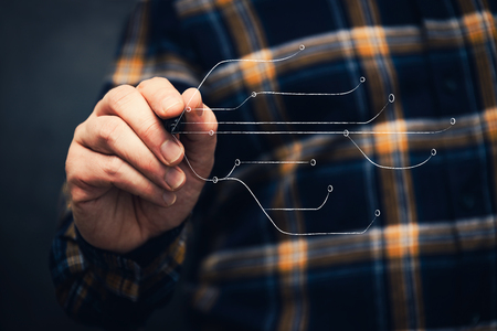 man with pen drawing internet conection lines design, with flannel shiirt and dark background Standard-Bild - 117449066
