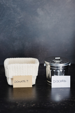 decluttering and tidying up concept: storage basket and gargabe bin to select which items to keep and which to discard 写真素材 - 119161427